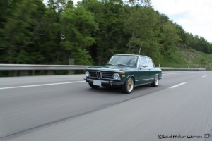 Rolling shot of a 1973 BMW 2002tii