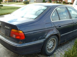 BMW E39 5-series with rusted quarter panels